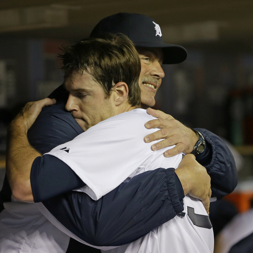 Detroit Tigers starting pitcher Doug Fister hugs pitching coach Jeff Jones after the sixth inning of Game 4 on Wednesday night. Fister was the winner in the 7-3 victory.