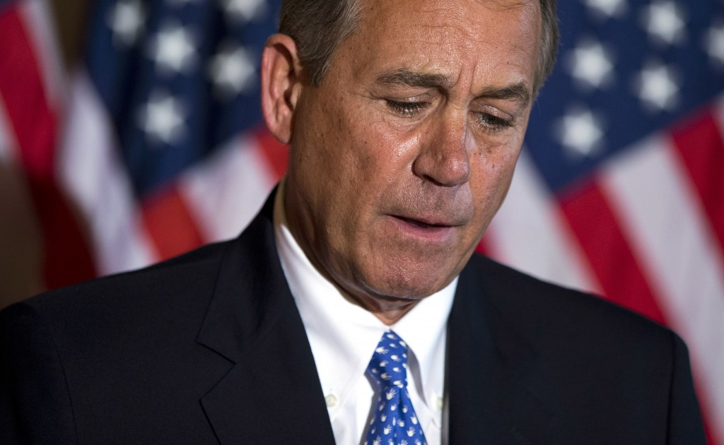 Speaker of the House Rep. John Boehner, R-Ohio, pauses during a news conference on the ongoing budget battle outside his office on Capitol Hill on Tuesday. Whether it's Republican John Boehner, the House speaker, or Democrat Harry Reid, the Senate majority leader, anyone associated with the shutdown is getting poor marks in the poll. Both earned a favorability ratings of just 18 percent.