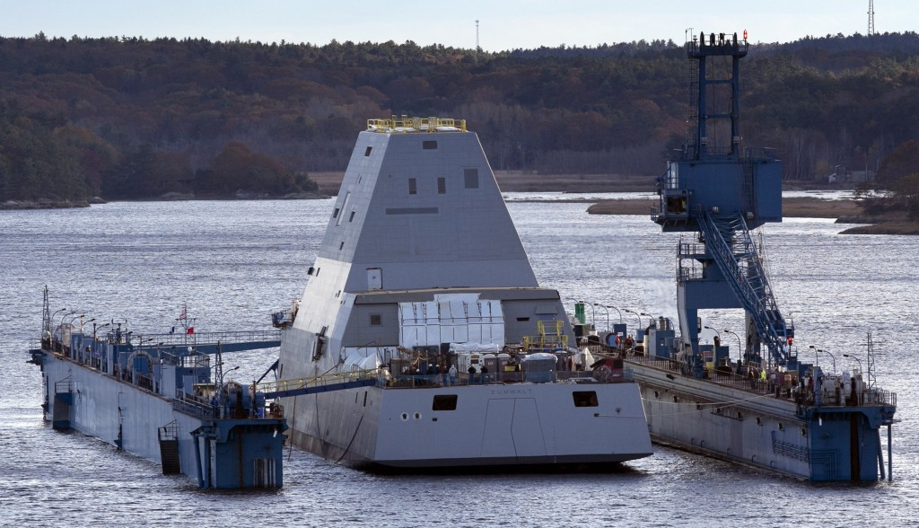 The first-in-class Zumwalt, the largest U.S. Navy destroyer ever built, floats off a submerged dry dock in the Kennebec River on Monday in Bath.