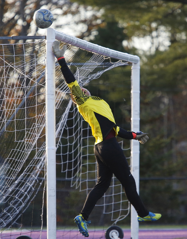 Gorham goalkeeper Matt Bennett tips the ball over the crossbar, depriving Deering of one of its best opportunities. Gorham will meet Scarborough next.