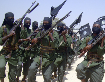 Al-Shabab fighters march with their weapons during military exercises on the outskirts of Mogadishu, Somalia, in February.