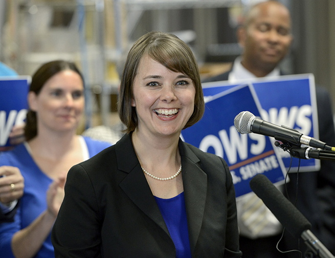 Shenna Bellows is all smiles as she launches her campaign to challenge Sen. Susan Collins with a press conference at Rising Tide Brewery in Portland on Wednesday.