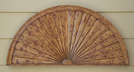 A faux fan serves as decoration in a residential home. Adding architectural and decorative elements such as faux wood beams, medallions and molding enhance otherwise simple rooms.
