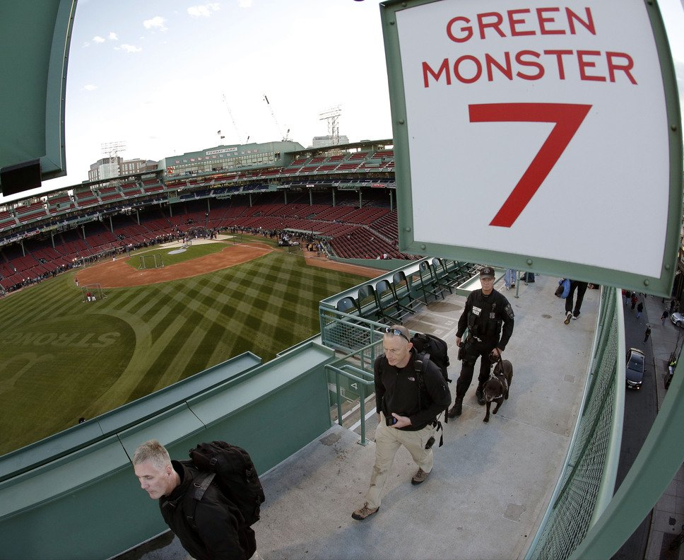 Security personnel perform a sweep of Fenway Park before Game 2 of the World Series. Game 6 presents a tougher task, because a Boston win will set off an exuberant celebration.