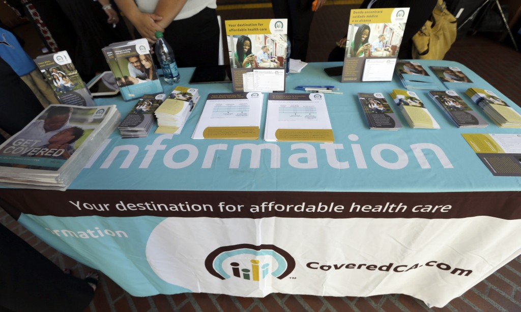 An information table is seen at Union Station in downtown Los Angeles as people seek information on state-provided health insurance, while a celebration is underway to inaugurate the first day people can enroll Tuesday, Oct. 1, 2013. Californians who buy their own health insurance and those who have been hoping for coverage began using the state's online marketplace Tuesday after it opened for business on the first day of enrollment.