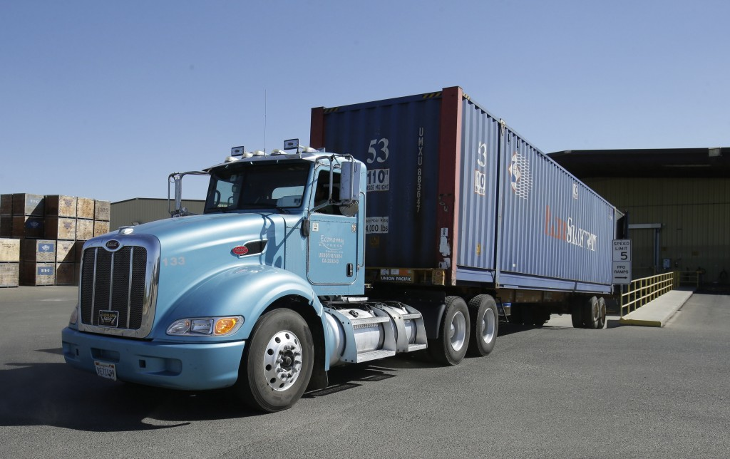 A truck loaded with almonds leaves the Hughson Nut, Inc., in Livingston, Calif., last month. The company was robbed twice by thieves pretending to be legitimate truck drivers.