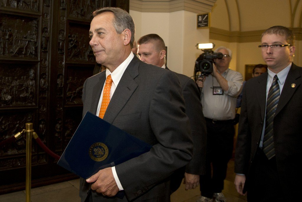 House Speaker John Boehner of Ohio arrives on Capitol Hill, Wednesday, Oct. 16, 2013, in Washington. Chaos among Republicans in the House of Representatives has left it to bipartisan leaders in the Senate to craft a last-minute deal to fend off a looming U.S. default and to reopen the federal government as a partial shutdown entered its 16th day.