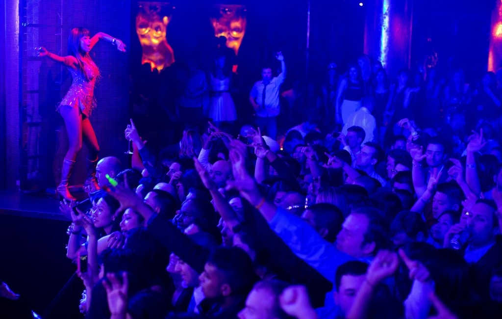 Revelers are led by professional dancers as DJ Afrojack plays his mixes at the XS nightclub in Las Vegas. A poll conducted this year by the national gambling lobby found that 26 percent of casino-goers now eschew wagering, and the city's growing mega-clubs are threatening to become the most lucrative draw for a town built on betting.