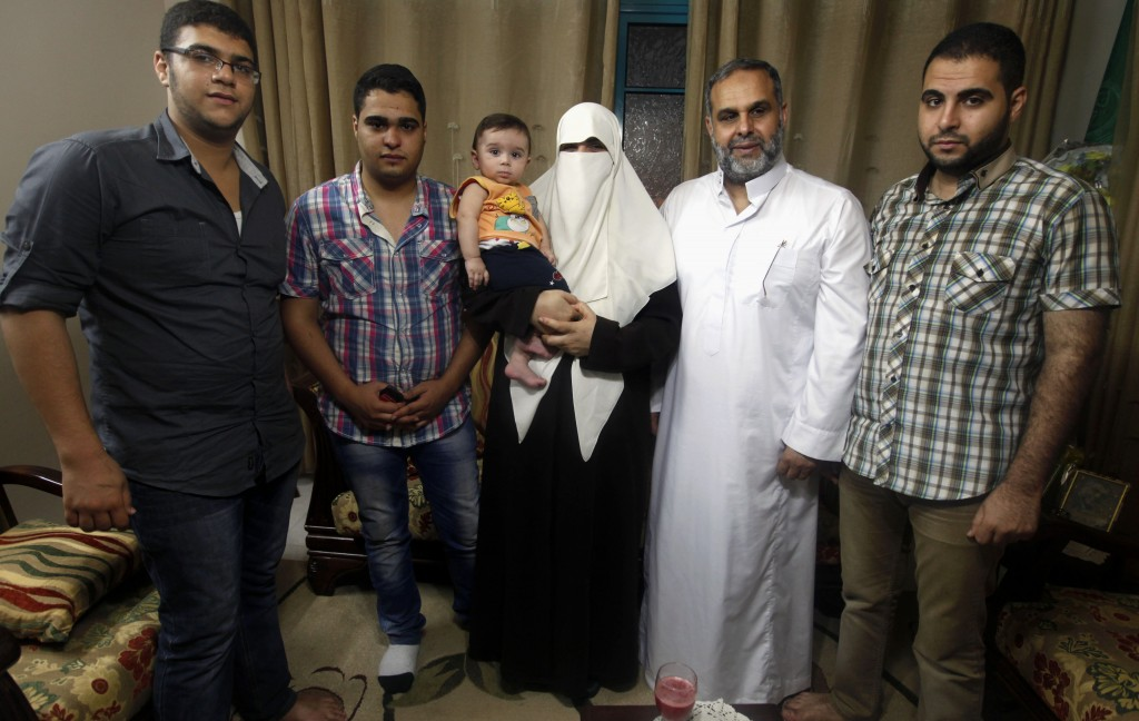 The Rantisi family gather at their house in Gaza City last June. From right are Baraa, Mohammed, Kifah, 10-month-old Mohammed, Malik, and Anaz. The family's story illustrates the draw the Muslim Brotherhood and its search for direction today.