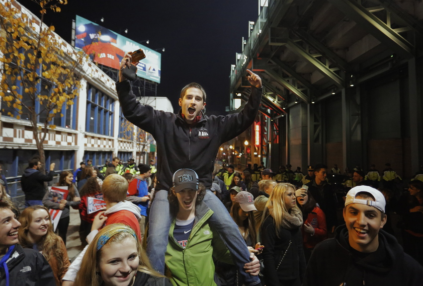 Gabe Souza/Staff Photographer Ben Eley of Blue Hill in Maine, now a college student in Boston, celebrates on the shoulders of a friend outside Fenway Park as the Red Sox built a lead early in Game 6.