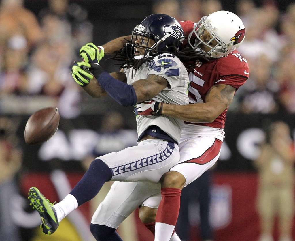 Seattle Seahawks cornerback Richard Sherman, 25, breaks up a pass intended for Arizona Cardinals wide receiver Michael Floyd in the first half Thursday at Glendale, Ariz.