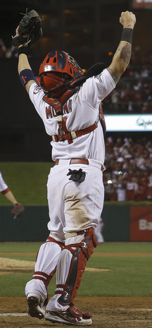 Cardinals catcher Yadier Molina celebrates Friday night after St. Louis wrapped up the National League Championship Series with a 9-0 victory over the Dodgers, earning a trip to the World Series for the 19th time in franchise history.