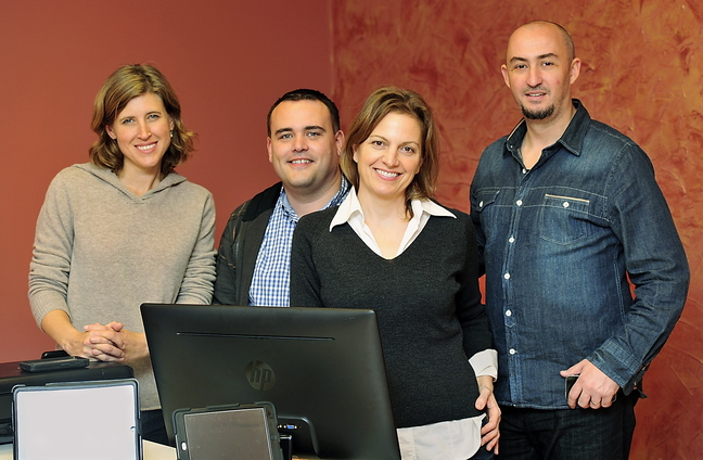 Emily Bernhard, second from right, with BizzieMe partners Julie Kingsley, John Moore and Dragos Stancu. Bernhard came to a StartUp Weekend last year – which led to the creation of her BizzieMe media venture.
