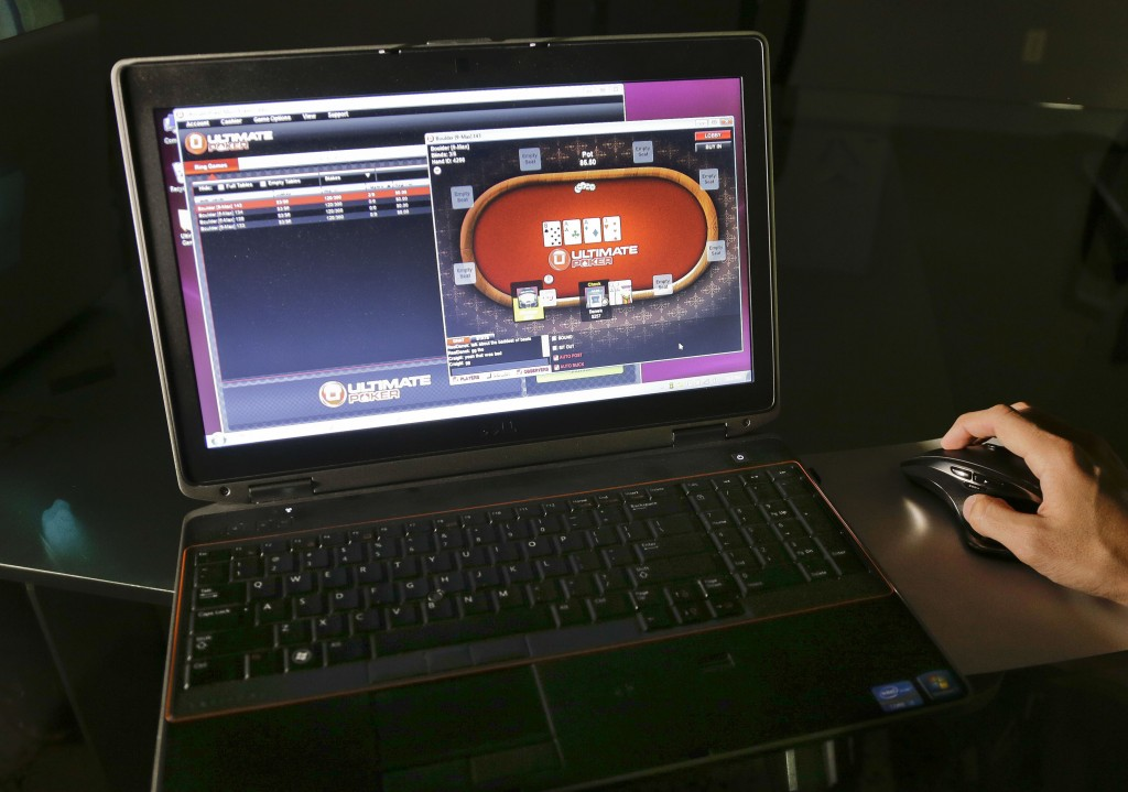 A sample poker game is played on the Ultimate Gaming website in Las Vegas. Ultimate Gaming began offering Internet gambling in Nevada earlier this year, and now New Jersey residents and visitors will be able to start gambling online on Nov. 26.