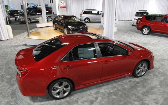 """The 2013 Toyota Camry remains near the top of Consumer Reports' reliability ratings, but it is among four Toyota models to lose the magazine's coveted """"recommended"""" label because they scored low in crash tests."""
