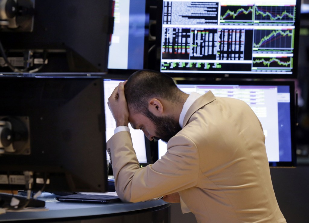Specialist Fabian Caceres works on the floor of the New York Stock Exchange on Monday. The stock market opened sharply lower as the U.S. government heads into a second week of a partial shutdown with no signs of a budget agreement in sight.
