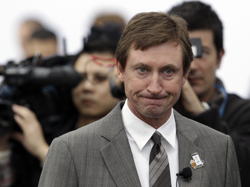 This is a Feb. 10, 2010 file photo showing hockey great Wayne Gretzky during an event at the Olympic Games in Vancouver, British Columbia. Two new statues of Gretzky have been vandalized in his hometown. Police in Brantford, Ontario, say they are studying a videotape sent to them of Monday's, Sept. 30, 2013, overnight vandalism, which involved defacing the statues with spray paint.