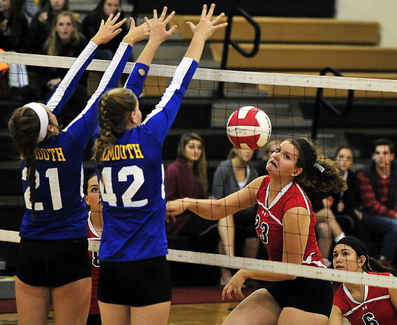 Katrina Meserve, left, and Julia Treadwell of Falmouth team up to block Scarborough's Mary Cleary. Falmouth's only losses this season have been against Scarborough – both in five sets.