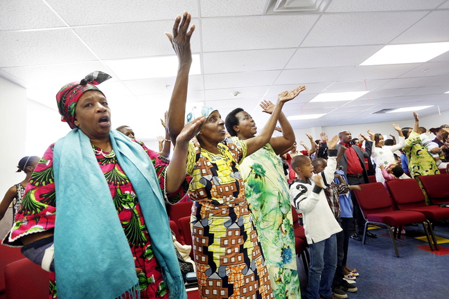 Members of the International Christian Fellowship worship at the church's new location in Westbrook. The community group has expanded since its beginning 12 years ago on Munjoy Hill and needed a larger space.