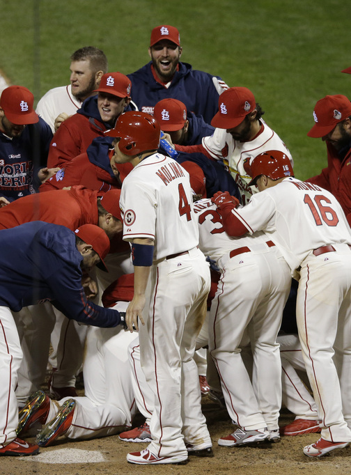 The St. Louis Cardinals were celebrating just as the Boston Red Sox started arguing Saturday night. Allen Craig is at the bottom of the pile after scoring when an obstruction call was made, giving St. Louis a 5-4 victory in the game and a 2-1 lead in the World Series. The teams will play Game 4 on Sunday night.
