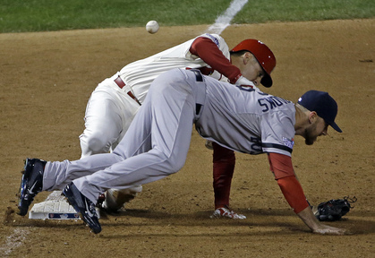 St. Louis Cardinals' Allen Craig gets tangled with Boston Red Sox's Will Middlebrooks during the ninth inning Saturday night in St. Louis. Middlebrooks was called for obstruction on the play and Craig went in to score the winning run. The Cardinals won 5-4 to take a 2-1 lead in the series.