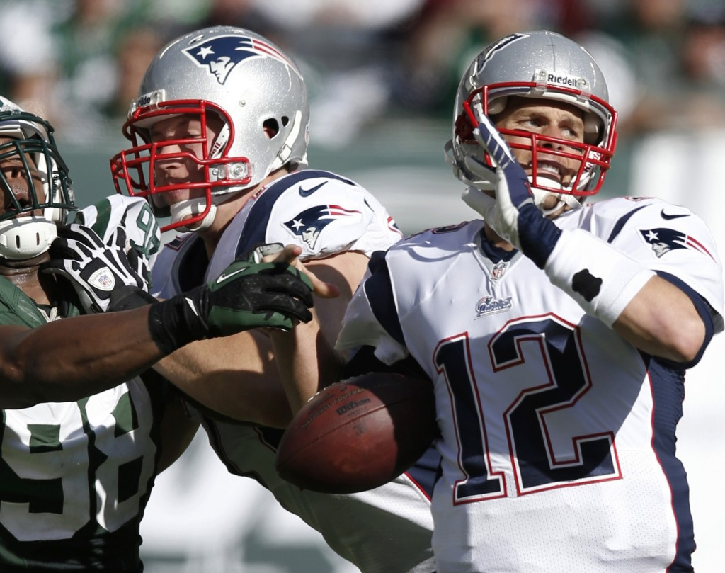 Tom Brady had a rough go of it in Sunday's loss to the Jets, such as when linebacker Quinton Coples overcame a block and knocked the ball away from the New England quarterback.