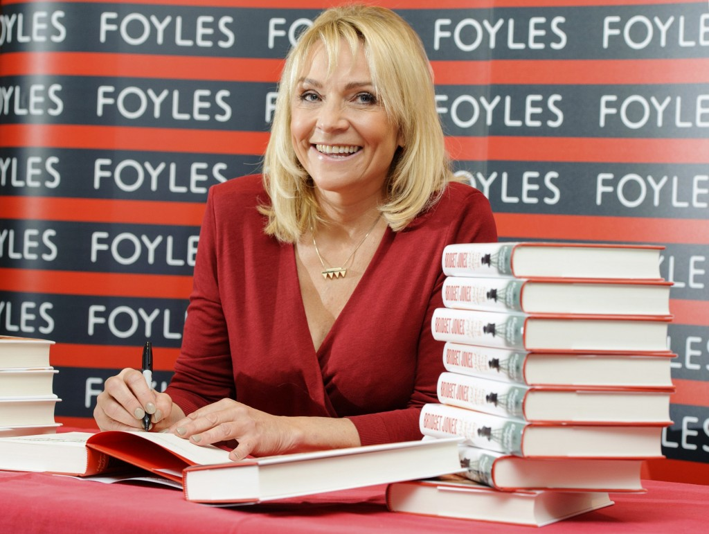 "British author Helen Fielding signs copies of her new book ""Bridget Jones: Mad About The Boy,"" at a bookshop in central London."