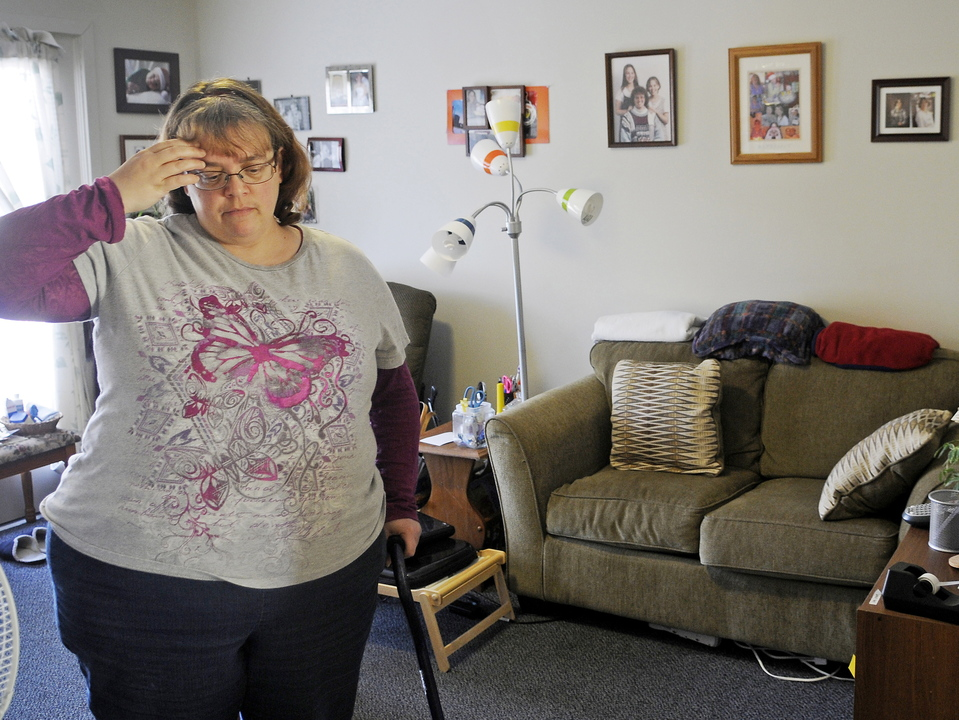 Cynthia Dow waits at her Augusta home last week for a ride through a MaineCare-sponsored driving service. Dow, whose back problems burden her walking, says she's often complained about the state's new medical ride service, but to no avail.