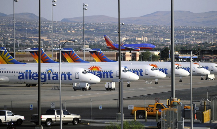 In this May 2013, file photo, Allegiant Air jets are parked at McCarran International Airport in Las Vegas. Allegiant Air is switching its first New Hampshire flight from Portsmouth to Manchester, saying the federal government shutdown delayed the installation of passenger-screening equipment at Portsmouth International Airport at Pease.
