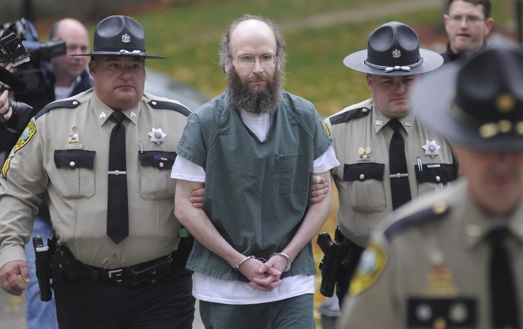 Christopher Knight is escorted into Kennebec County Superior Court in Augusta on Monday to enter pleas for multiple burglaries and thefts while living in the woods of central Maine for 27 years. The North Pond Hermit agreed to plead guilty in exchange for receiving an alternative sentence with the Co-Occurring Disorders Court, a special, intensive supervision program where he will live and work in the community while reporting weekly to a judge.