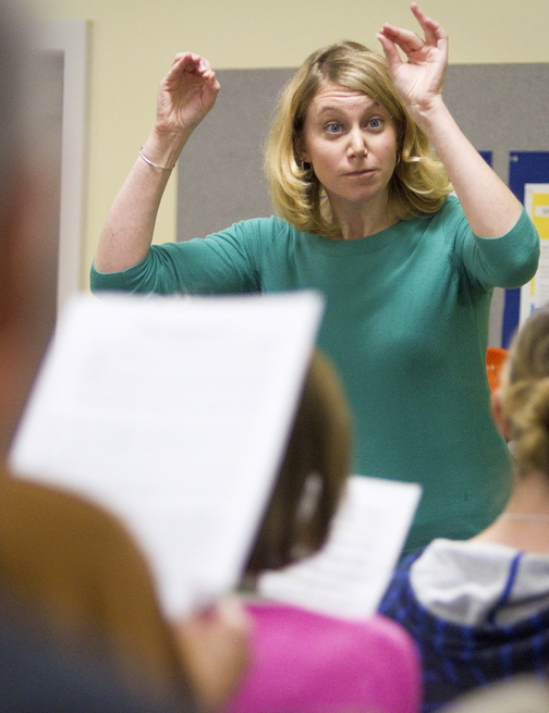Emily Isaacson, the new director of the Oratorio Chorale, directs the chorus furing practice at the Mid-Coast Presbyterian Church in Topsham.