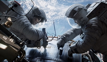 "Sandra Bullock, left and below, as Dr. Ryan Stone and George Clooney as Matt Kowalsky in ""Gravity."""