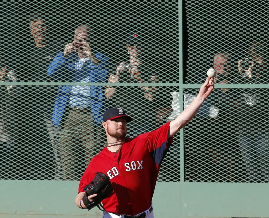 Jon Lester throws during practice on Monday at Fenway Park. Lester will start Game 1 of the World Series for the Red Sox against the Cardinals on Wednesday night.