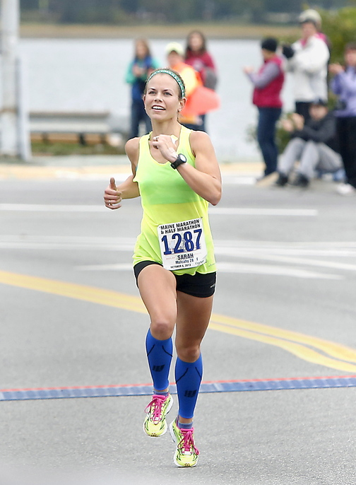 Maine half-marathon winner Sarah Mulcahy, 28, of Baring Plantation approaches the finish line Sunday in Portland.