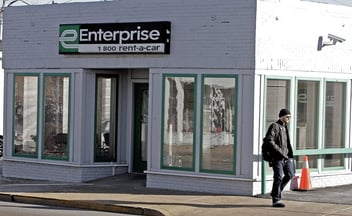 An Enterprise Rent-A-Car storefront is shown in Maplewood, Mo. The company plans to hire 11,000 new workers by August.