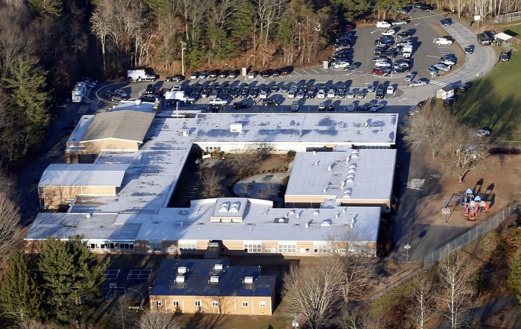 FILE - This Dec. 14, 2012 aerial file photo shows Sandy Hook Elementary School in Newtown, Conn. Contractors demolishing Sandy Hook Elementary School are being required to sign confidentiality agreements forbidding public discussion of the site, photographs or disclosure of any information about the building where 26 people were fatally shot in December 2012.