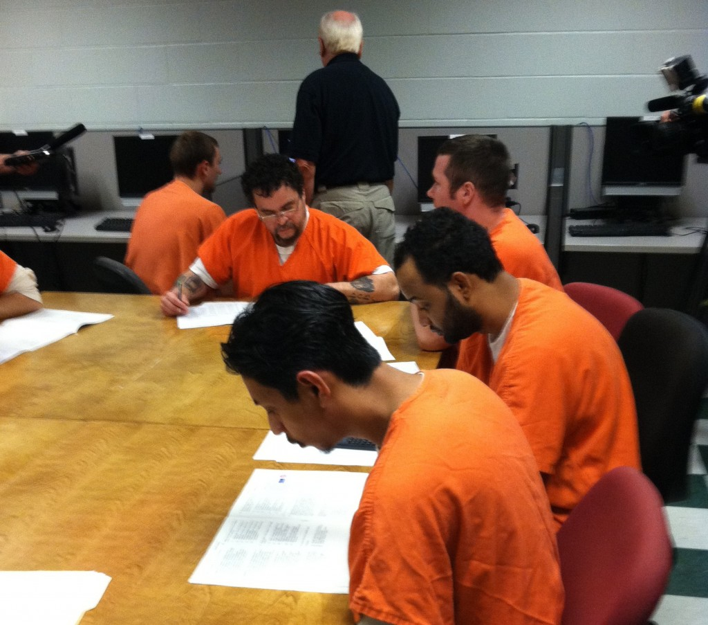 A group of Cumberland County Jail inmates takes a pre-test Wednesday to determine readiness to take a test toward earning their General Educational Development degree.