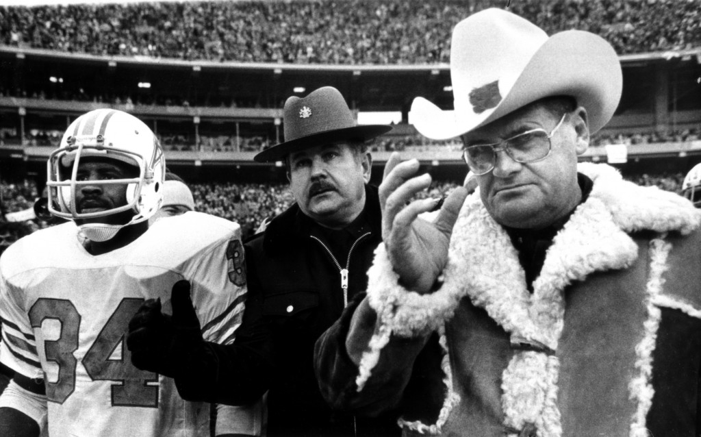 In this Jan. 6, 1980, file photo, Houston Oilers Coach Bum Phillips and running back Earl Campbell leave field after the Oilers' loss to the Pittsburgh Steelers in the AFC championship in Pittsburgh. Phillips, the folksy Texas football icon who coached the Oilers and New Orleans Saints, died Friday at age 90.