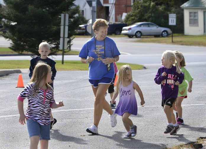 Kathy Harmon leads a kids' running club started by Kimberly Kelly last year and continuing at the Sebago Elementary School.