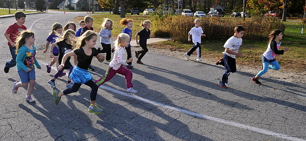 Students at Sebago Elementary School get 15 minutes to do as many laps as they can around the circular driveway to build endurance.