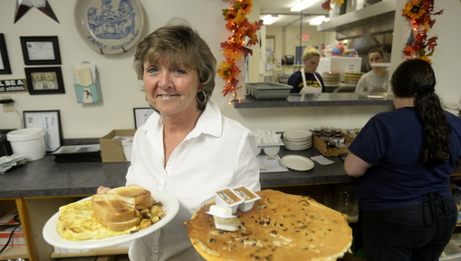 Server Sue Roberge shows off chocolate chip pancakes and a farmer's omelette at Mayo's Family Restaurant in Berwick.