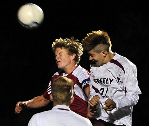A corner kick produces a goal as Miles Shields of Greely, right, heads the ball past Noah Lobozzo of Gray-New Gloucester. Greely will take on York in the regional semifinals Saturday.