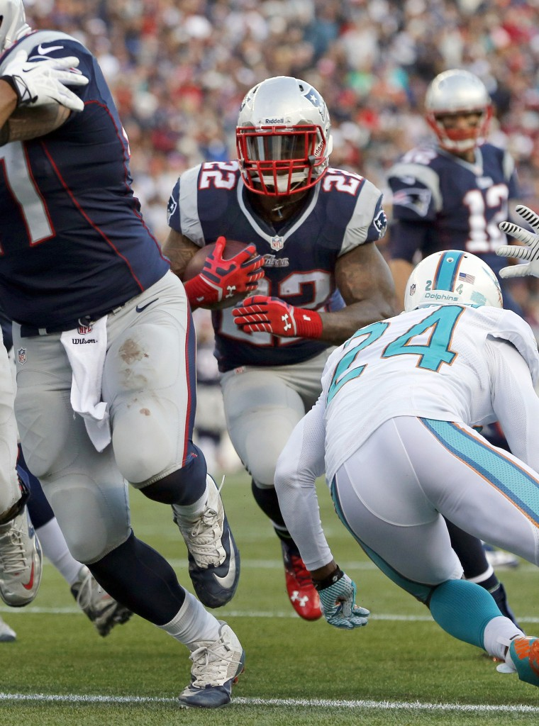 Miami Dolphins cornerback Dimitri Patterson (24) attempts to stop New England Patriots running back Stevan Ridley (22), in the second half of an NFL football game Sunday, Oct. 27, 2013, in Foxborough, Mass. (AP Photo/Michael Dwyer)