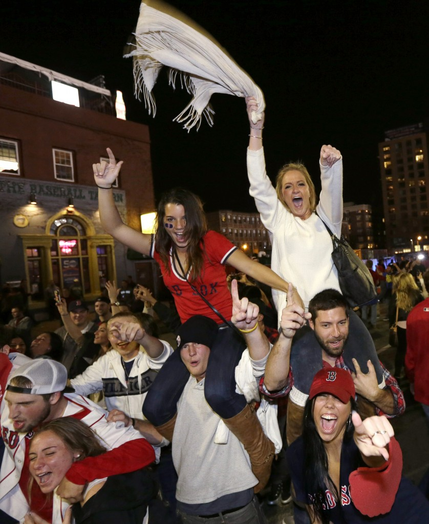Boston Red Sox fans celebrate in the street near Fenway Park following Game 6 of baseball's World Series between the Red Sox and the St. Louis Cardinals on Wednesday, Oct. 30, 2013, in Boston. The Red Sox won 6-1 to win the series.