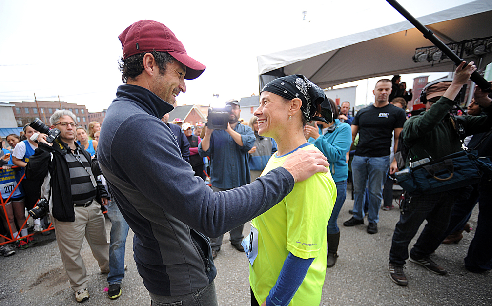 Patrick Dempsey greets Jeni Schumacher of Greenville, S.C., before the start of the fifth annual Dempsey Challenge on Saturday in Lewiston. Schumacher, a nine -times melanoma cancer survivor, cycled from Greenville with 16 other cyclists on the team Challenge to Conquer Cancer. The group relayed over 1,300 miles and 5,550 feet of climbing on their route.