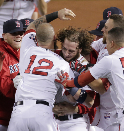 Jarrod Saltalamacchia, center, is mobbed by his teammates after his RBI single in the bottom of the ninth inning Sunday gave the Red Sox a 6-5 win in Game 2 of the ALCS.