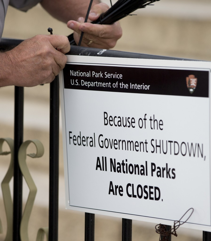 A National Park Service employee posts a sign on a barricade closing access to the Lincoln Memorial on Tuesday. Maine's U.S. senators haven't made constructive contributions to the dialogue over the federal shutdown, readers say.