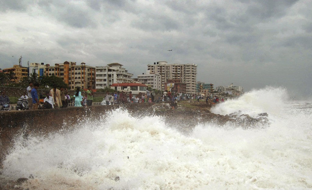 Waves pound the Bay of Bengal coast in Vishakhapatnam, India, on Saturday. Hundreds of thousands of people living along India's eastern coastline took shelter from a massive, powerful cyclone that was headed for land packing destructive winds and heavy rains.