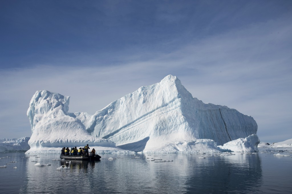 AP An inflatable boat carries tourists past an iceberg along the Antarctic Peninsula.