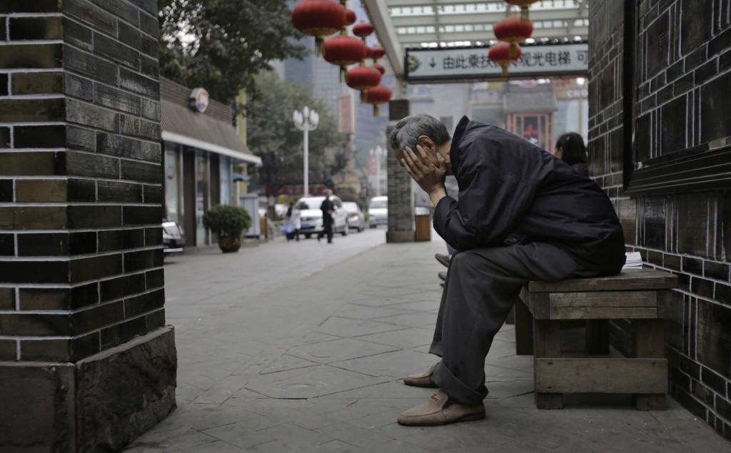 An elderly man sits on a bench in Chongqing, China. With the world's population aging faster than ever before, families and governments are struggling to decide who is responsible for the care of the elderly.